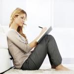 Woman writing chatline greeting